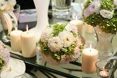 stock photo of adornments  - Flower and candle decoration for a wedding - JPG