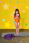 Fashion Summer Little Girl, Bright Background, Stars, Studio. Charming Child In Swimsuit Holding Ice poster