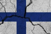 Finland Flag On The Cracked Earth. National Flag Of Finland. Earthquake Or Drought Concept poster