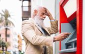 Happy Mature Man Withdraw Money From Bank Cash Machine With Debit Card - Senior Male Doing Payment W poster