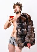 Guy Attractive Rich Posing Fur Coat On Naked Body. Sexy Sleepy Rich Macho Tousled Hair Drink Wine Is poster