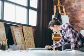 Art Craft Hobby. Leisure And Lifestyle. Woman With Painting On Floor And Modeling Tool In Hand. Artw poster