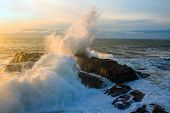 Seascape. Waves Of The Atlantic Ocean Crashing Against A Rock At Sunset. Portugal poster