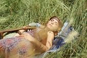 Young Hippie Woman Relaxing Lying On The Grass poster