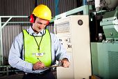 foto of workplace safety  - male occupational health and safety officer inside factory doing inspection - JPG