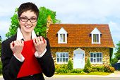 picture of real-estate agent  - Friendly smiling real estate business woman and a nice house - JPG