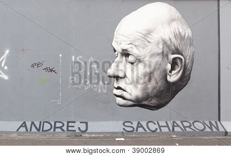 BERLIN - AUGUST 22: Famous graffito of academician Andrei Sakharov on Berlin Wall at East Side Gallery August 22, 2012 in Berlin