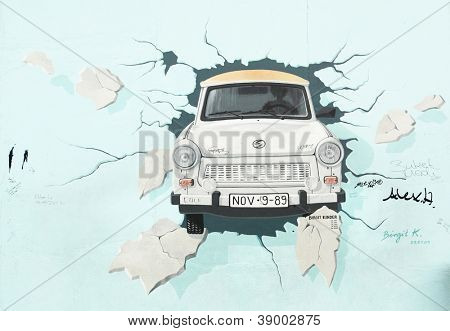 BERLIN - AUGUST 22: Famous painting by Birgit Kinder of the Trabant on Berlin Wall at East Side Gallery August 22, 2012 in Berlin