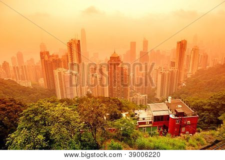 Hong Kong cityscape with mountain in red tone.
