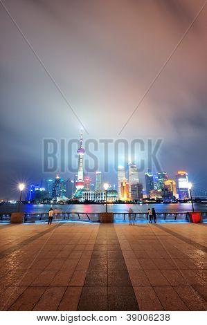 Shanghai urban city skyline over walkway at night