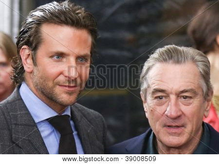 """NEW YORK-NOV 12: Actor Bradley Cooper (L) and Robert DeNiro attend the premiere of """"Silver Linings Playbook"""" at the Ziegfeld Theatre on November 12, 2012 in New York City."""