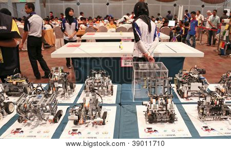 SUBANG JAYA - NOVEMBER 10: Competition robots await judges inspection at the World Robot Olympaid on November 10, 2012 in Subang Jaya, Malaysia. This year's theme is Robots connecting people.