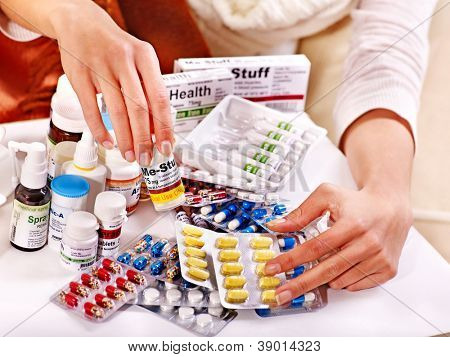 Hand holding remedy.  Medicine.