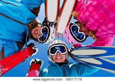 Skiing, winter, snow, sun and fun - female skiers enjoying winter vacations