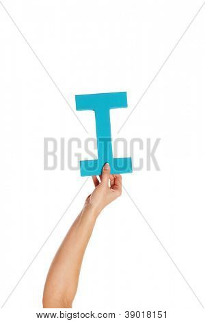 Female hand holding up the uppercase capital letter I isolated against a white background conceptual of the alphabet, writing, literature and typeface