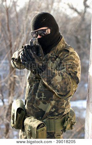 Portrait Of Soldier With A Handgun