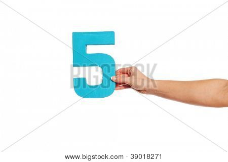 Female hand holding up the number 5 against a white background conceptual of numbers, measurement, amount, quantity, accounting and mathematics