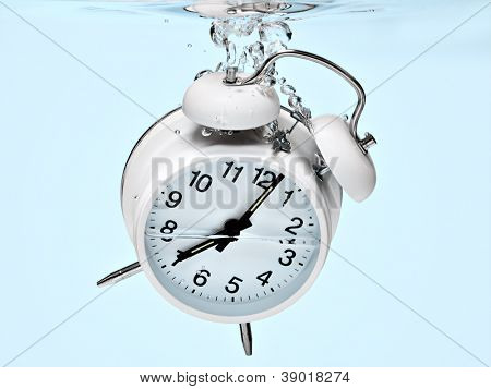 Alarm clock sinking under water