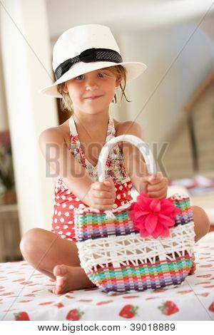 Girl Wearing Swimming Costume With Straw Hat And Bag