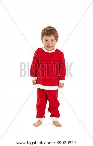 Portrait of cheerful little kid in santa costume, smiling at camera.