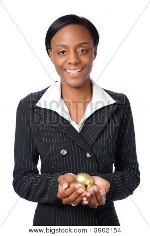 Woman Holding Gold Eggs