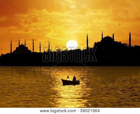 Sunset over Istanbul Silhouette and the fishing boat
