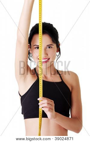 Pretty smiling woman holding measurement type - isolated on white