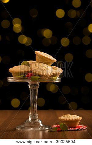 Christmas mince pies with festive background
