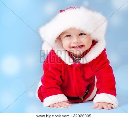 Sweet baby wearing Santa costume, over blue background with copyspace