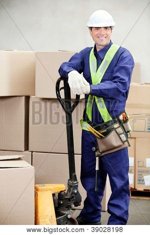 Portrait of confident warehouse worker standing in workplace