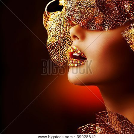 Luxury Golden Makeup. Beautiful Professional Holiday Make-up. Sexy Gold Lips.Fashion Art Portrait.Jewelry