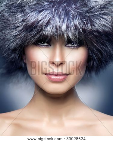 Winter Girl. Fur Fashion. Beautiful Woman in Fur Hat. Winter Woman Portrait