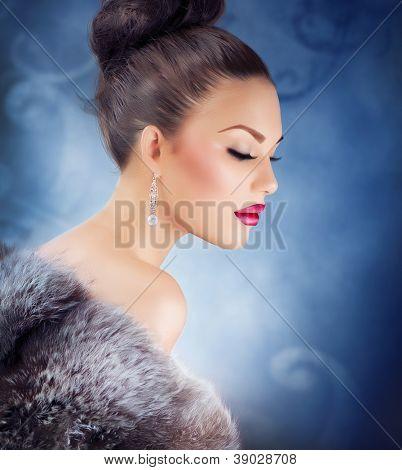 Winter Girl in Luxury Fur Coat. Fashion Fur. Jewelry. Jewellery. Luxury Christmas Woman Portrait.Beautiful Model