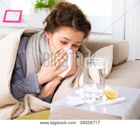 Flu or Cold. Sneezing Woman Sick Blowing Nose.