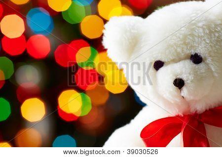 Image of white soft toy bear on sparkling background