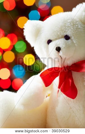Image of white soft toy bear on sparkling background