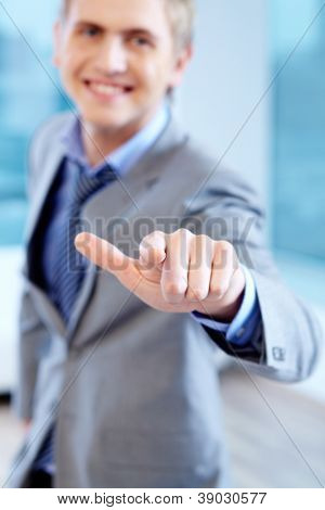 Close-up of businessman hand pointing at you