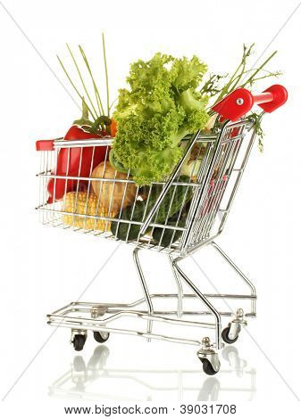 Fresh vegetables in metal trolley isolated on white background