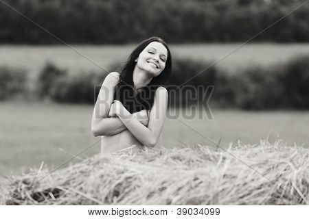 portrait of a girl next to haystack