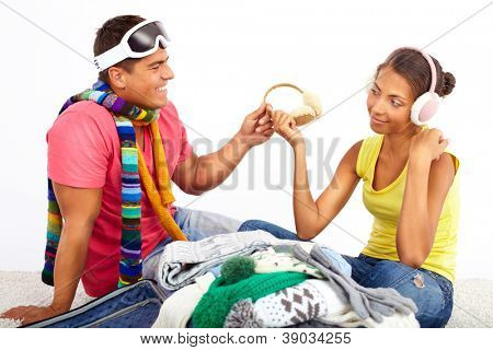 Portrait of cute girl and handsome man preparing for journey