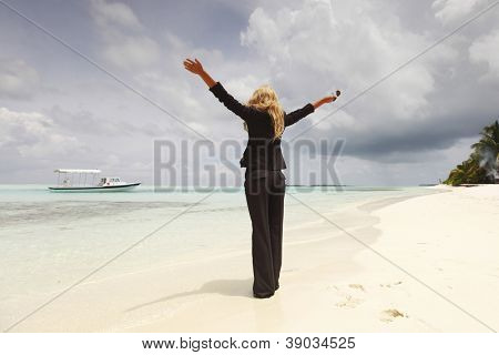 happy  business woman on the desolate ocean coast
