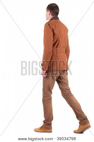 Back view of walking  handsome man in jeans and jacket.  walking young guy in jeans and  jacket. Rear view people collection.  backside view of person.  Isolated over white background.