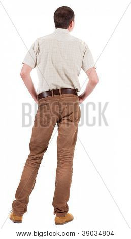 Back view of handsome man in shirt  looking up.   Standing young guy in jeans and  jacket. Rear view people collection.  backside view of person.  Isolated over white background.