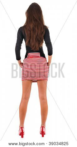 back view of standing young beautiful  woman.  blonde girl in red dress and  kitten heels watching. Rear view people collection.  backside view of person.  Isolated over white background.