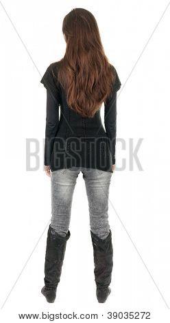 volta a vista da bela jovem de pé.  menina morena de jeans e suéter assistindo. Traseira vie