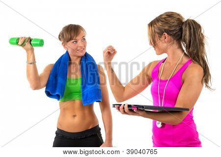 Young woman is training muscles by female coach