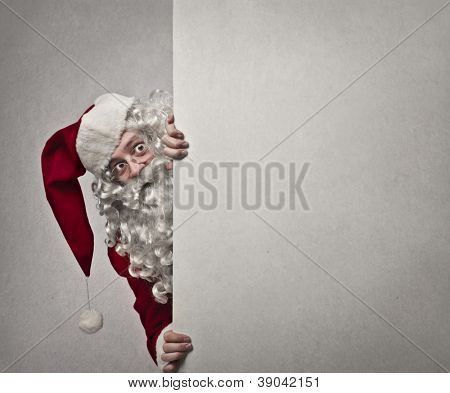 Santa Claus faces leaning against a wall