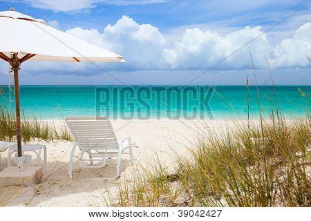 Chairs under umbrella on stunning Caribbean beach