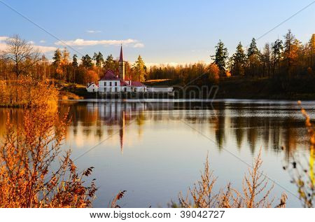beautiful Priory palace and lake at autumn sunset, Gatchina, Saint-Petersburg, Russia