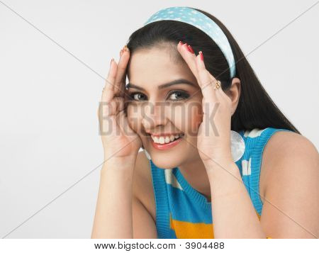 Asian Woman Covering Her Face With Her Palms